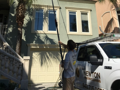 windows being cleaned by our window cleaning team