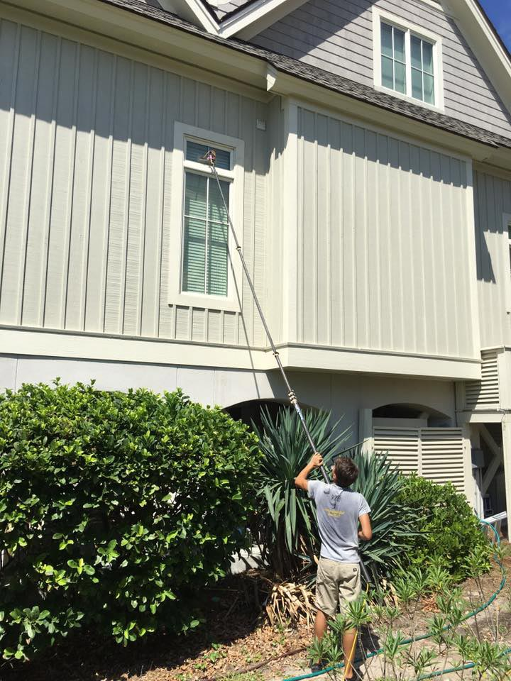 cleaning windows at a hilton head residence