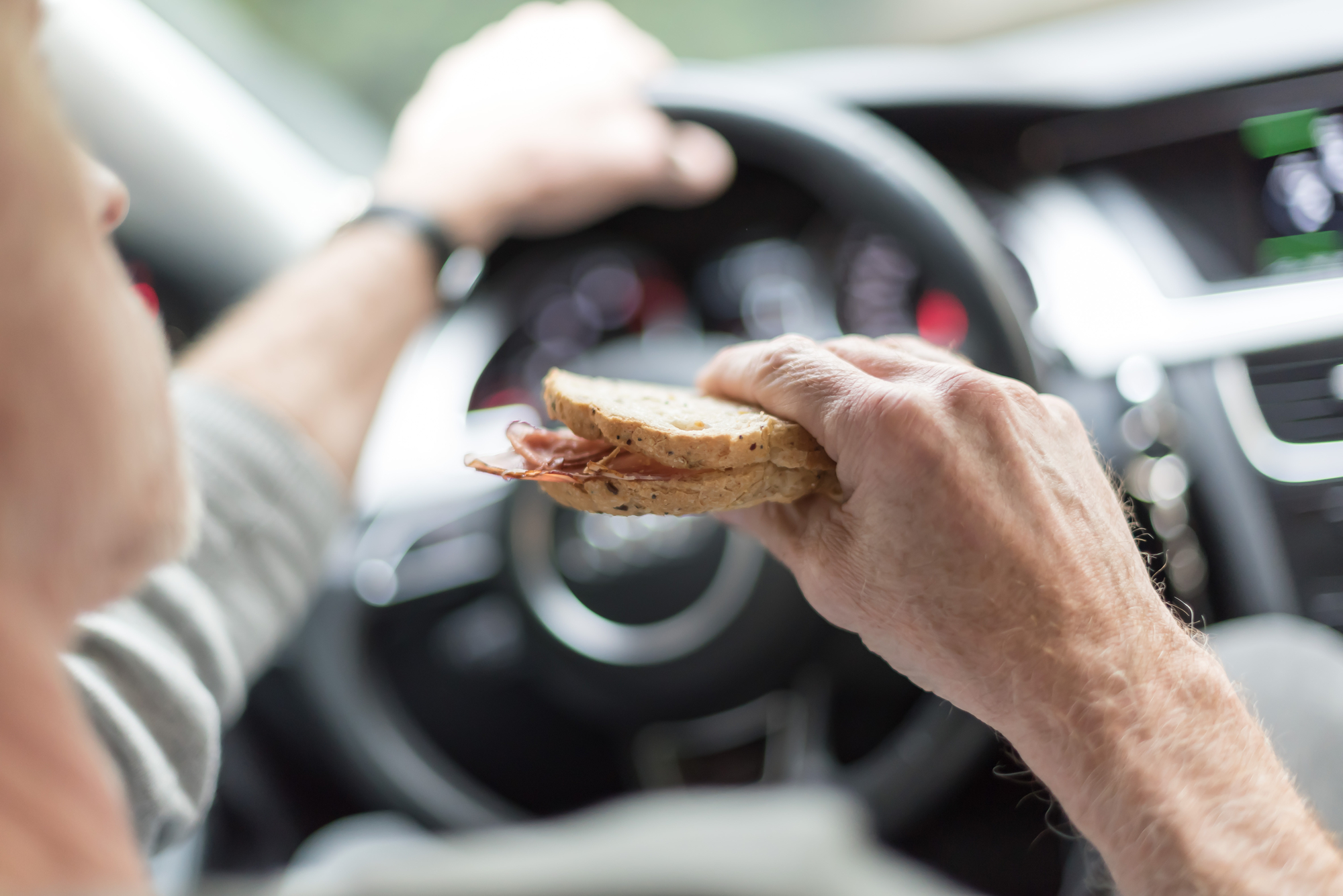 Driver eating a sandwich while