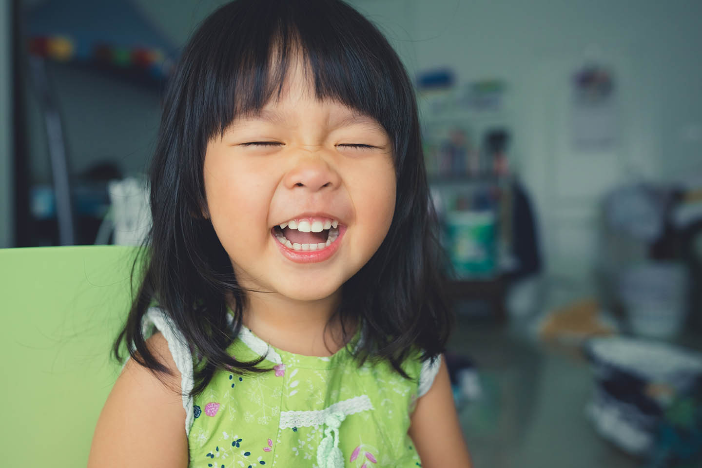 Child laughing and squinting eyes