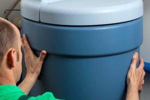 plumber setting up water softener