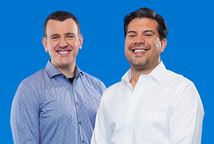 Connected's founders, Mike Stern and Damian McCabe standing together proudly