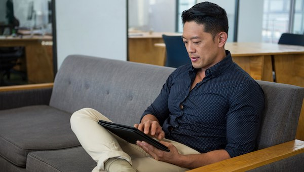 man working with data on a tablet