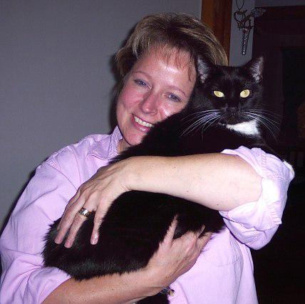 Brenda holding cat 'Jill'