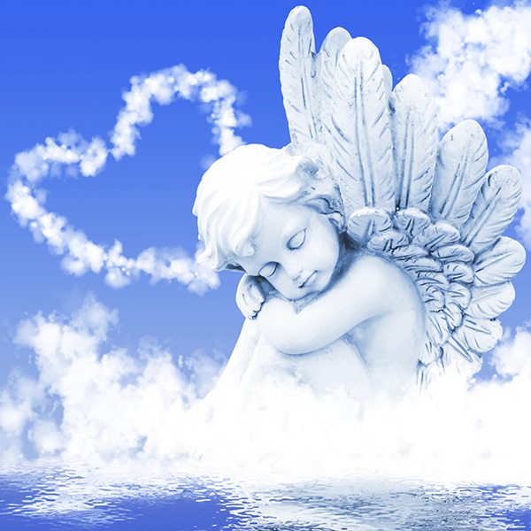 Cherub statue sitting in clouds with heart cloud behind