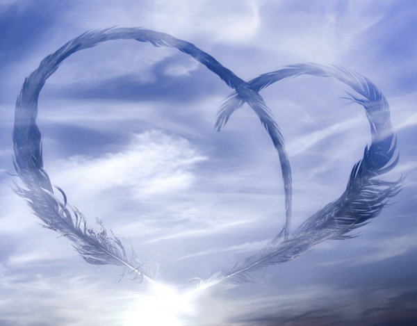 Blue sky with feathers in the shape of a heart superimposed over the sky
