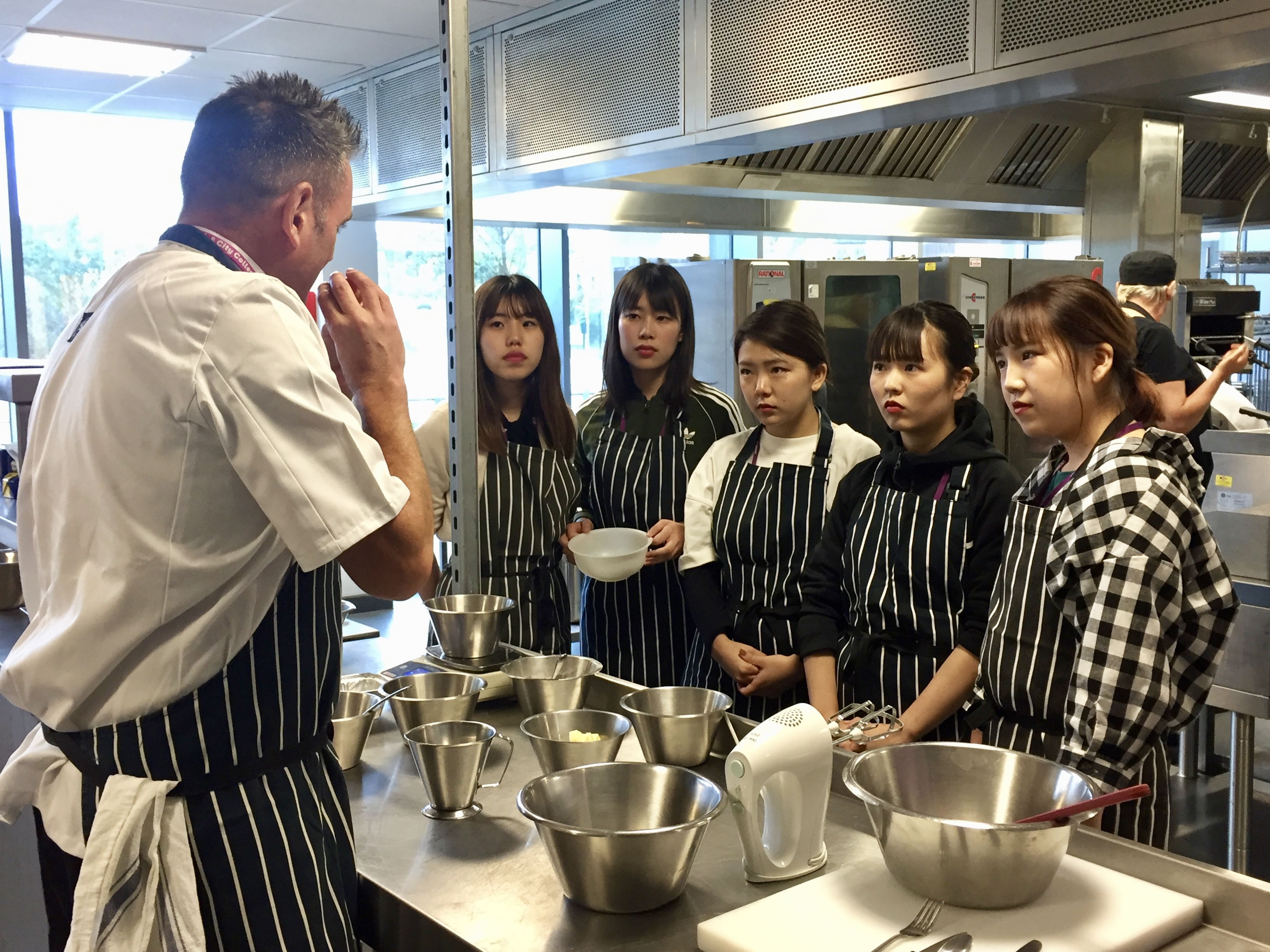 Japanese homestay students learning to cook