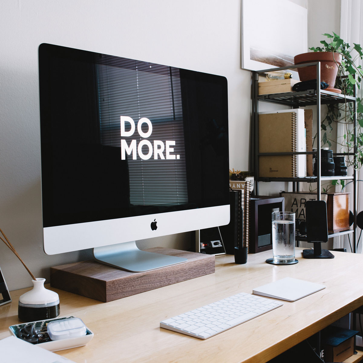 Computer on desk with Do More message on screen