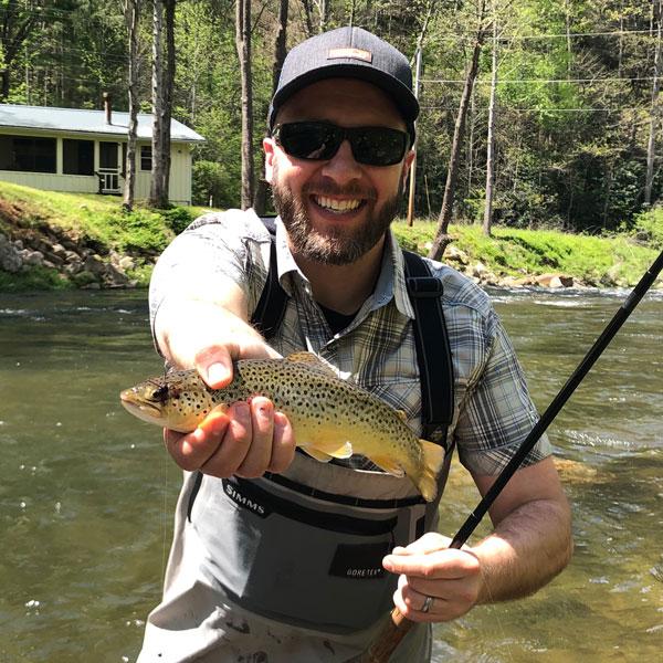 An Intellum employee fishing