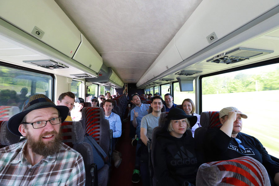 A group of Intellum employees riding a bus together