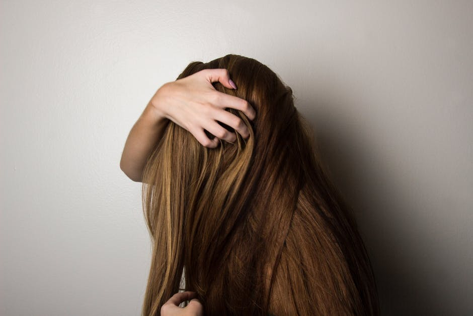 girl scratching her hair