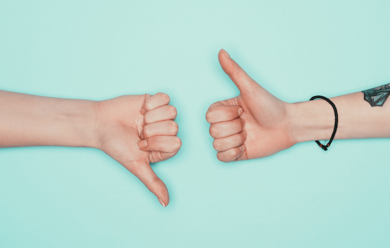 "Two hands on a blue background, one gives the ""thumbs up"" and the other ""thumbs down"" - Neovation Learning Solutions"