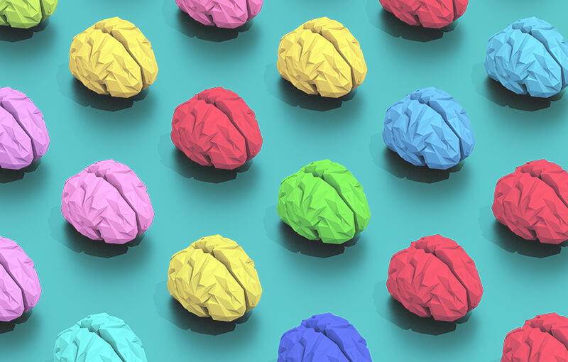 Repeating pattern of multicolored brains on a light blue background.