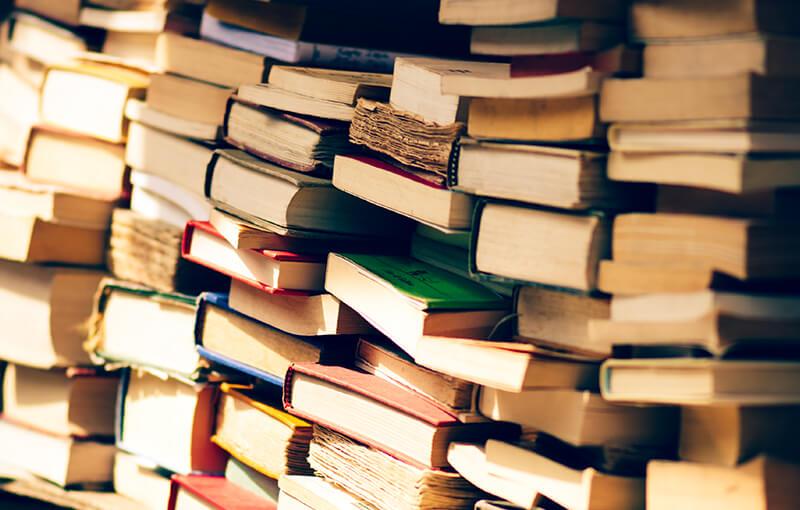 Multiple stacks of books.