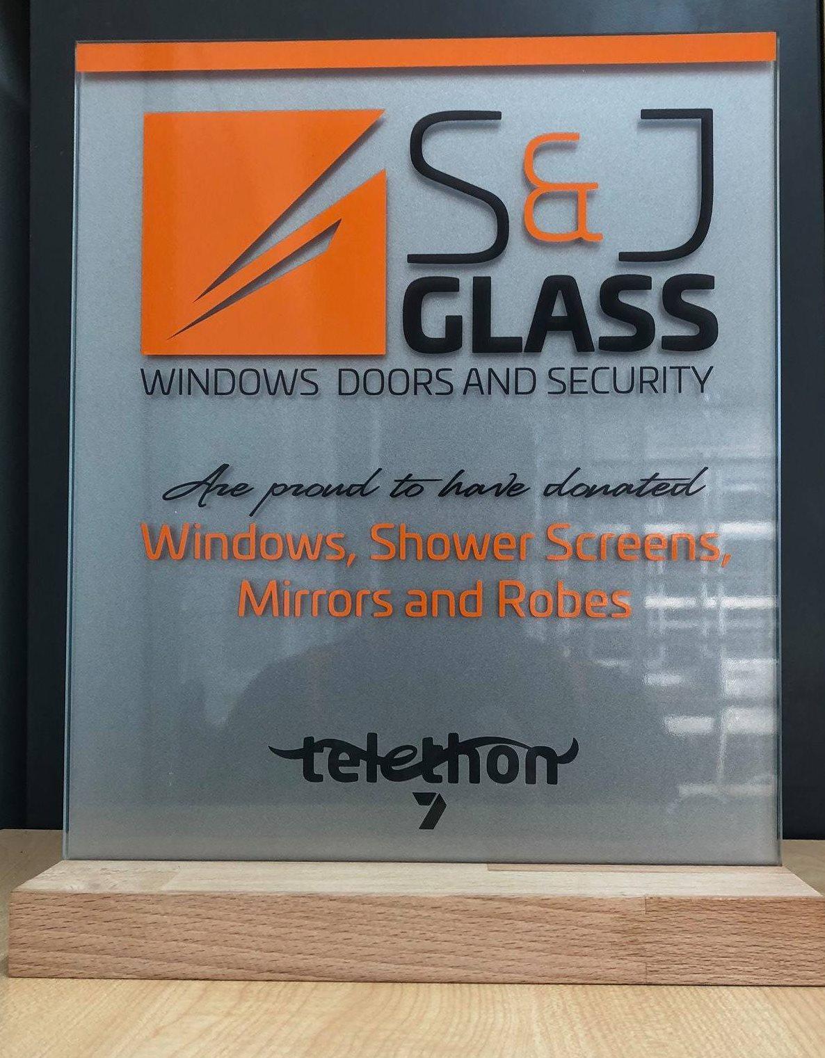 S & J Glass Telethon donation plaque