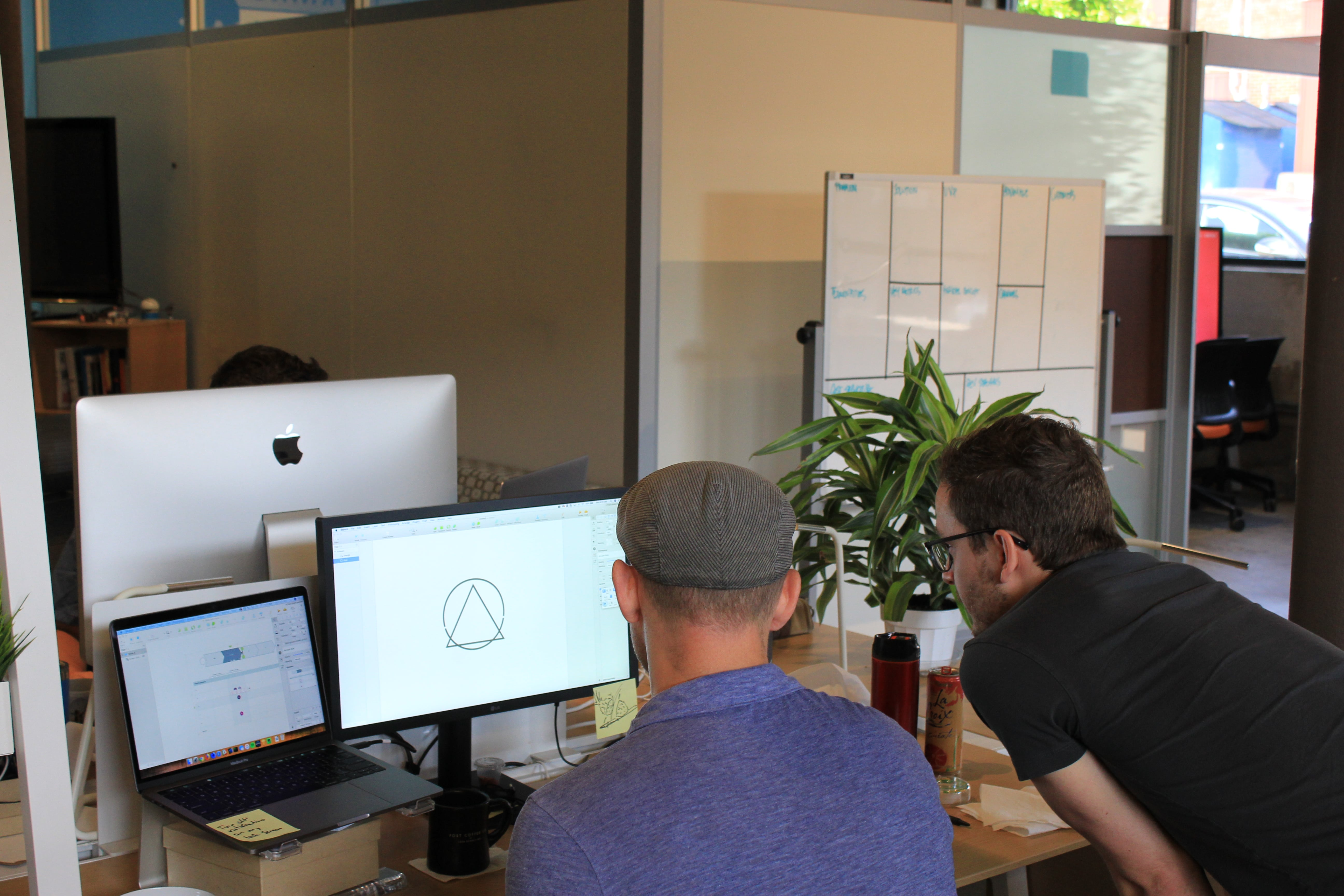 people working on design at digital product agency