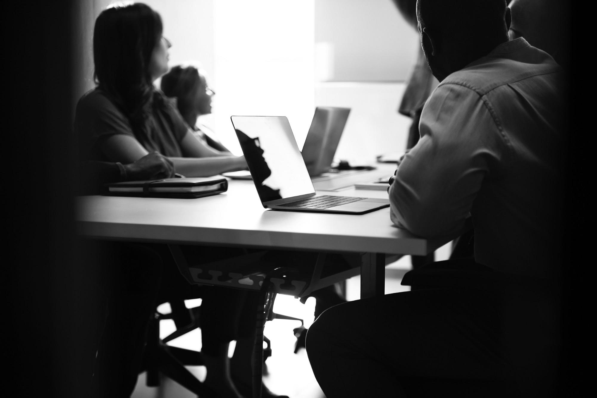 Team working on agile sprint retrospective at desk