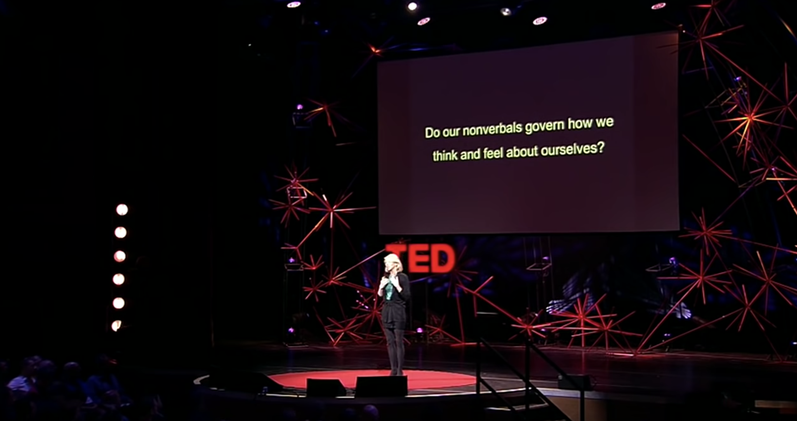 amy cuddey social psychologist giving ted talk on stage