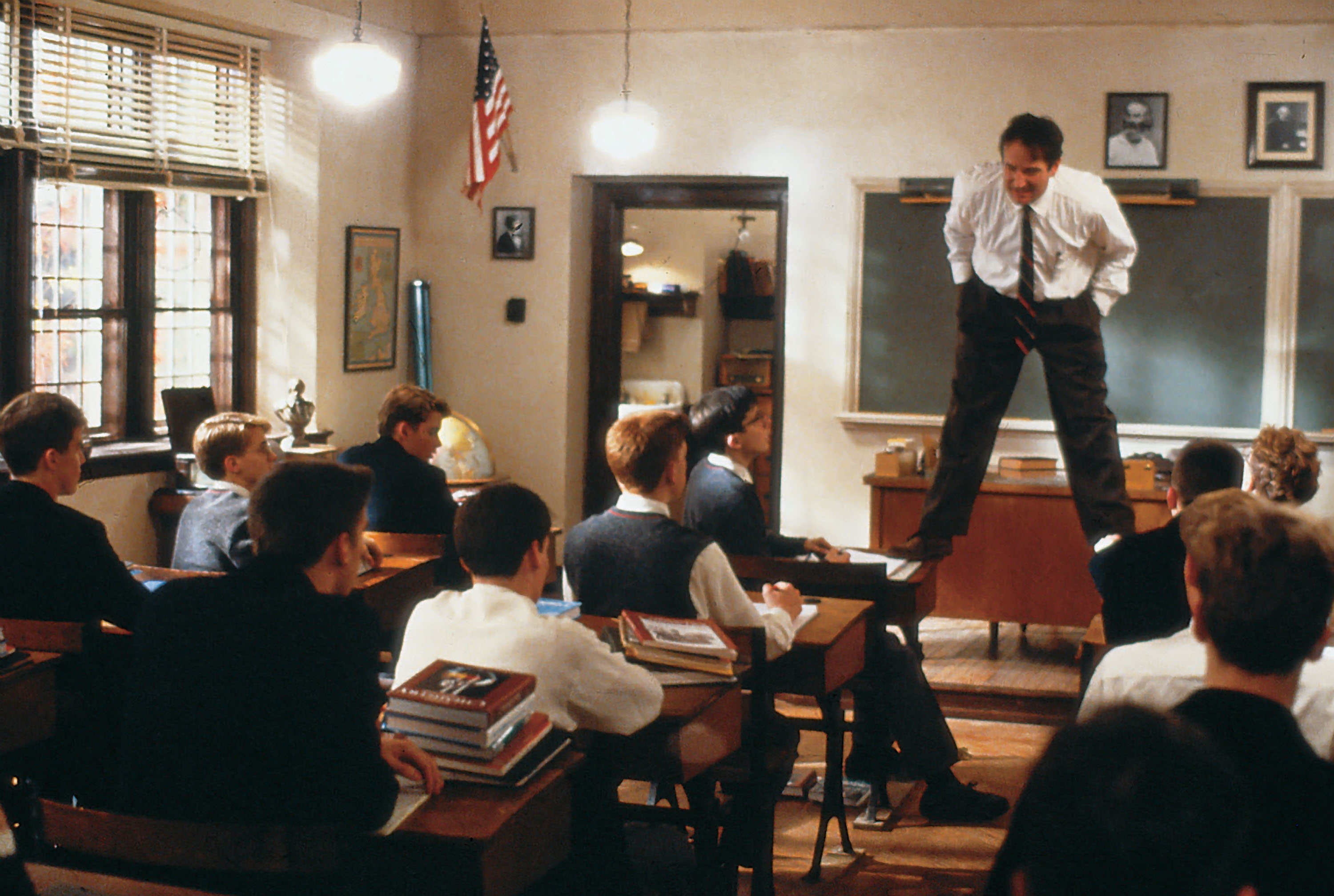dead poets society scene where robin williams stands on desks in classroom