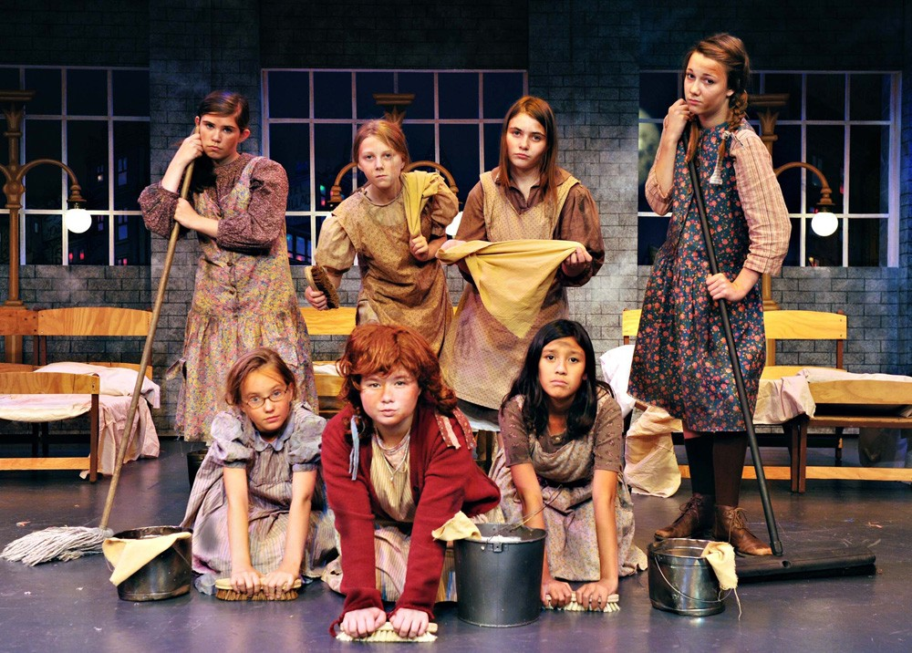 group of kids on stage for annie musical