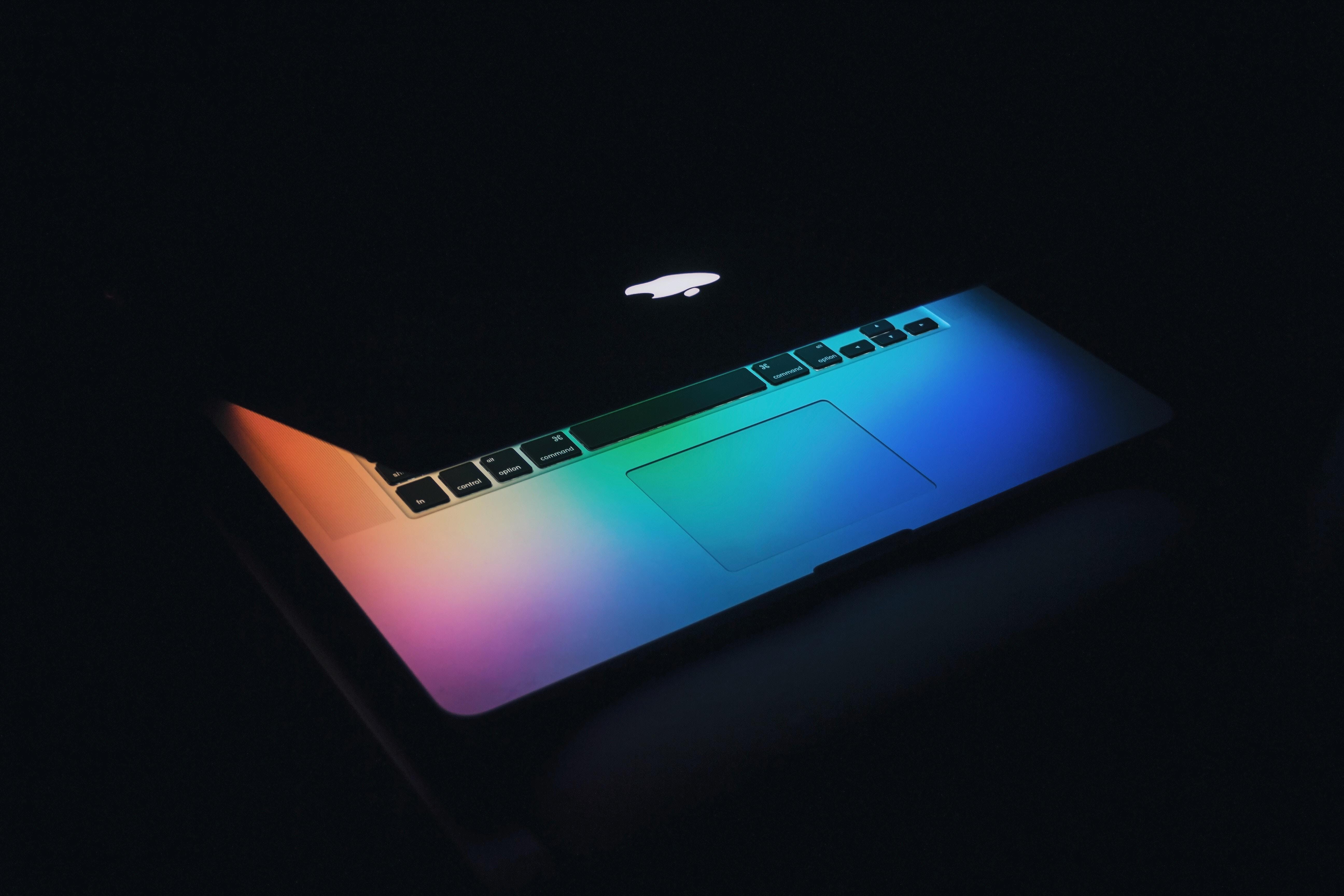 apple computer with rainbow light