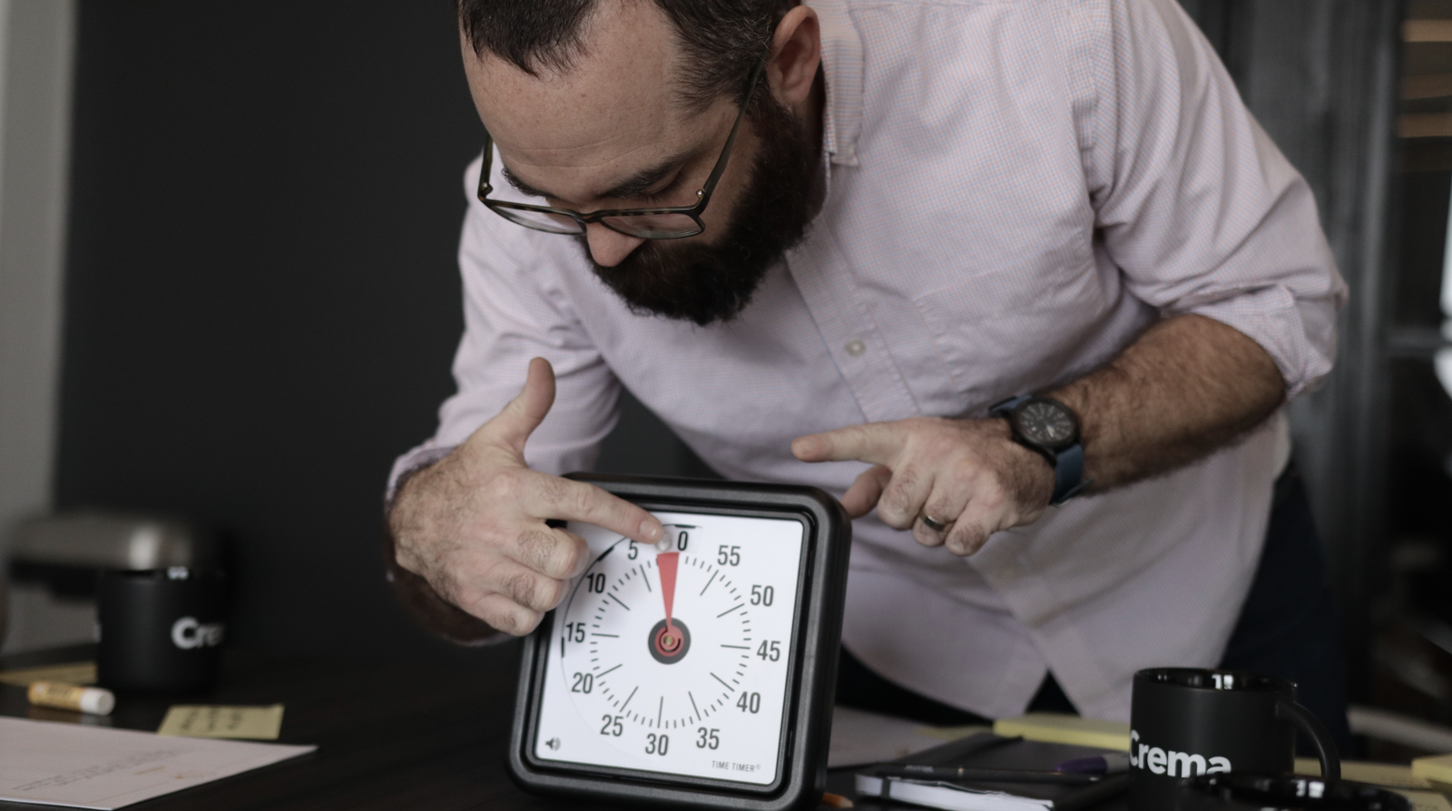 man setting timer on table