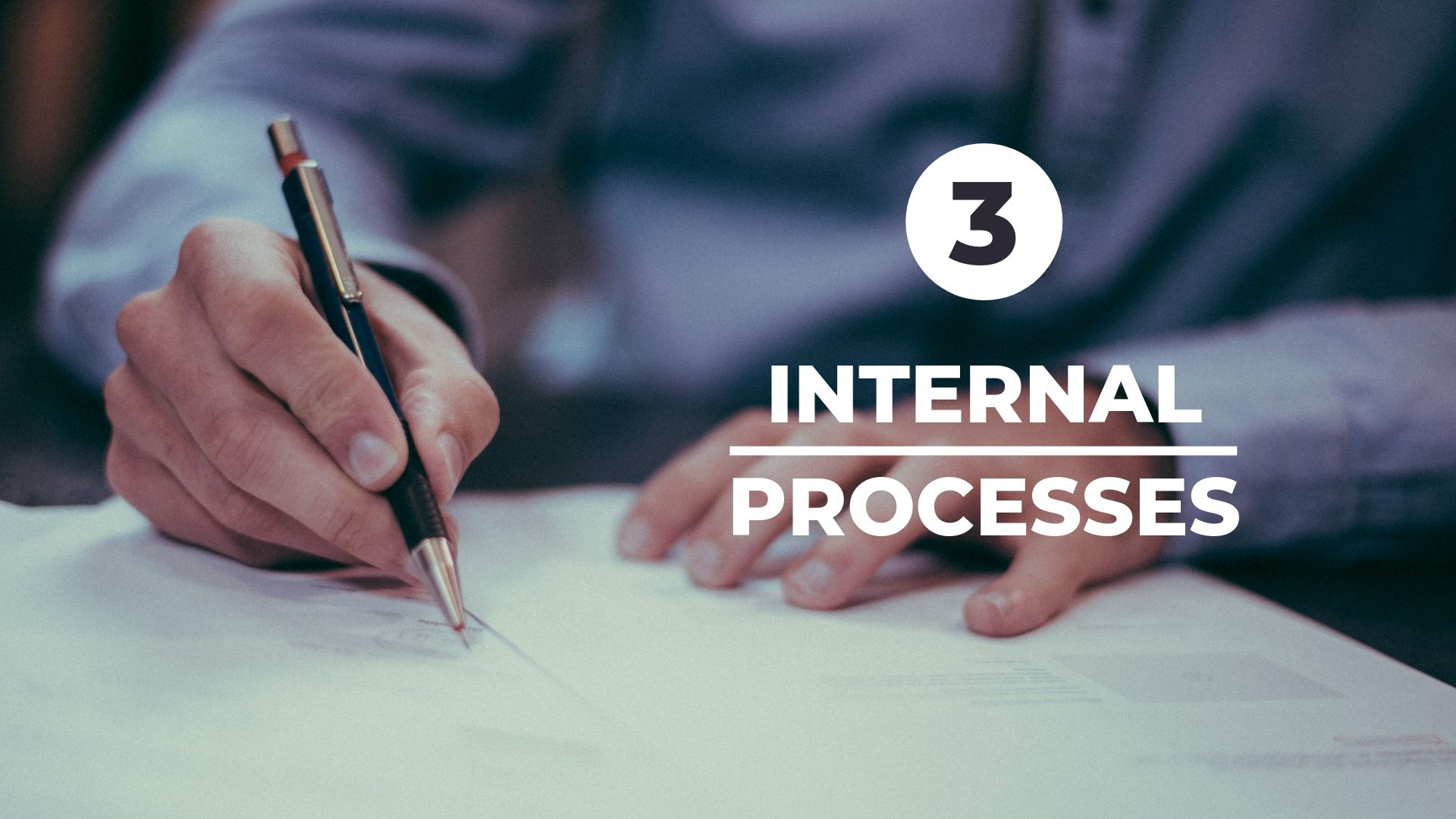internal processes with man writing something on paper in background