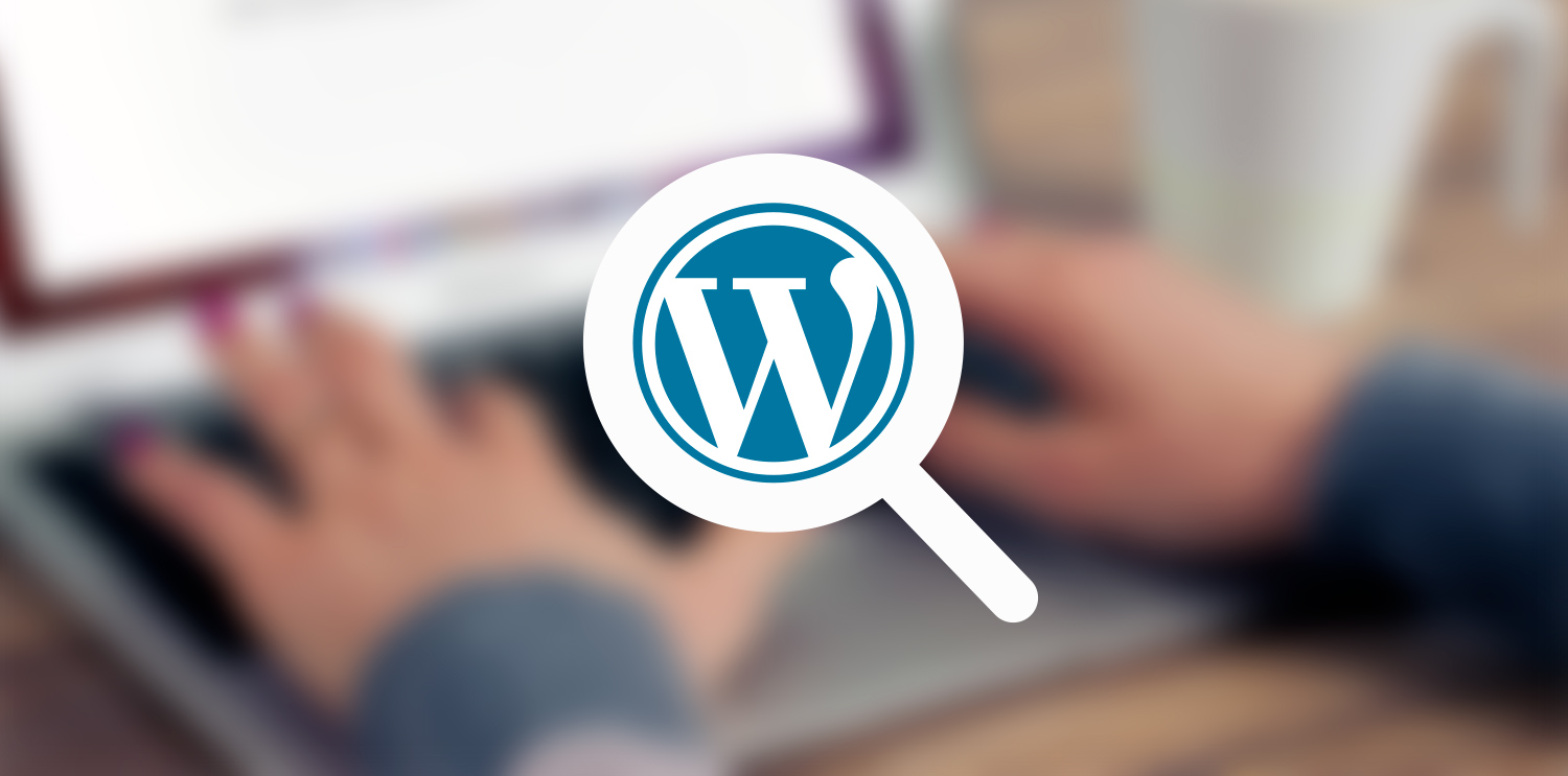 The wordPress logo with a blurred image behind