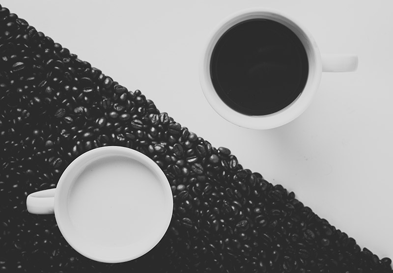 Two Coffee cups, one black and one with milk to demonstrate Segmentation