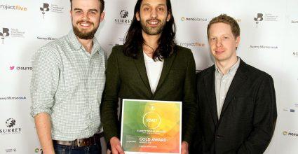 Watb team receiving an award