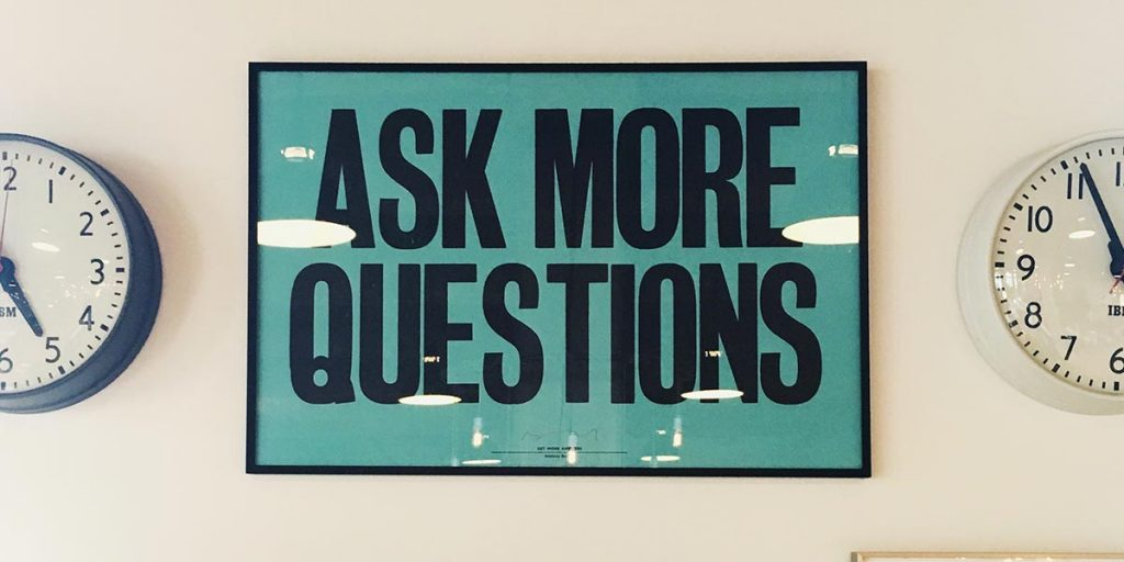 "Plaque saying ""Ask More Questions"""