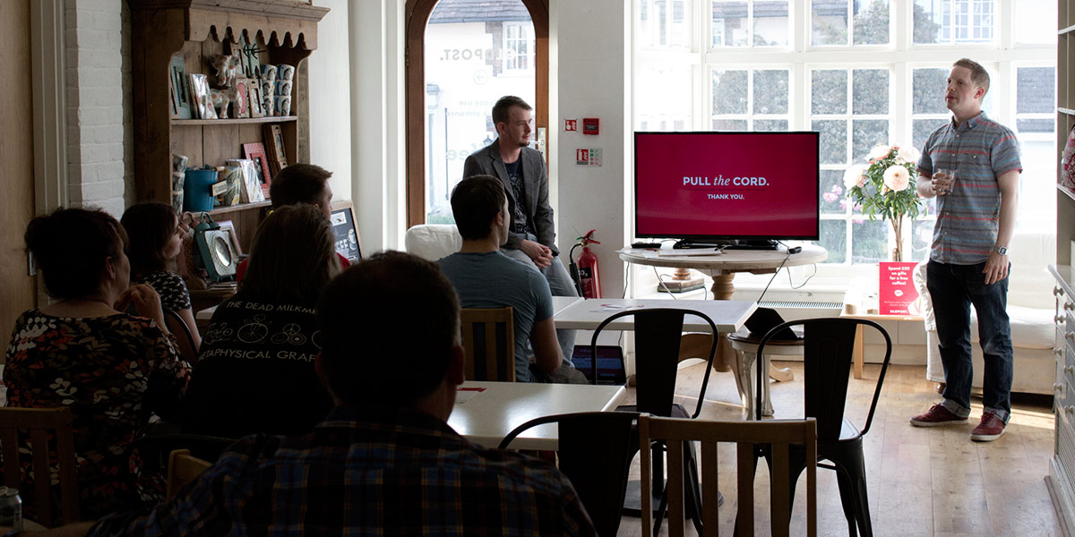 A person holding a Developer seminar in The Oldpost cafe