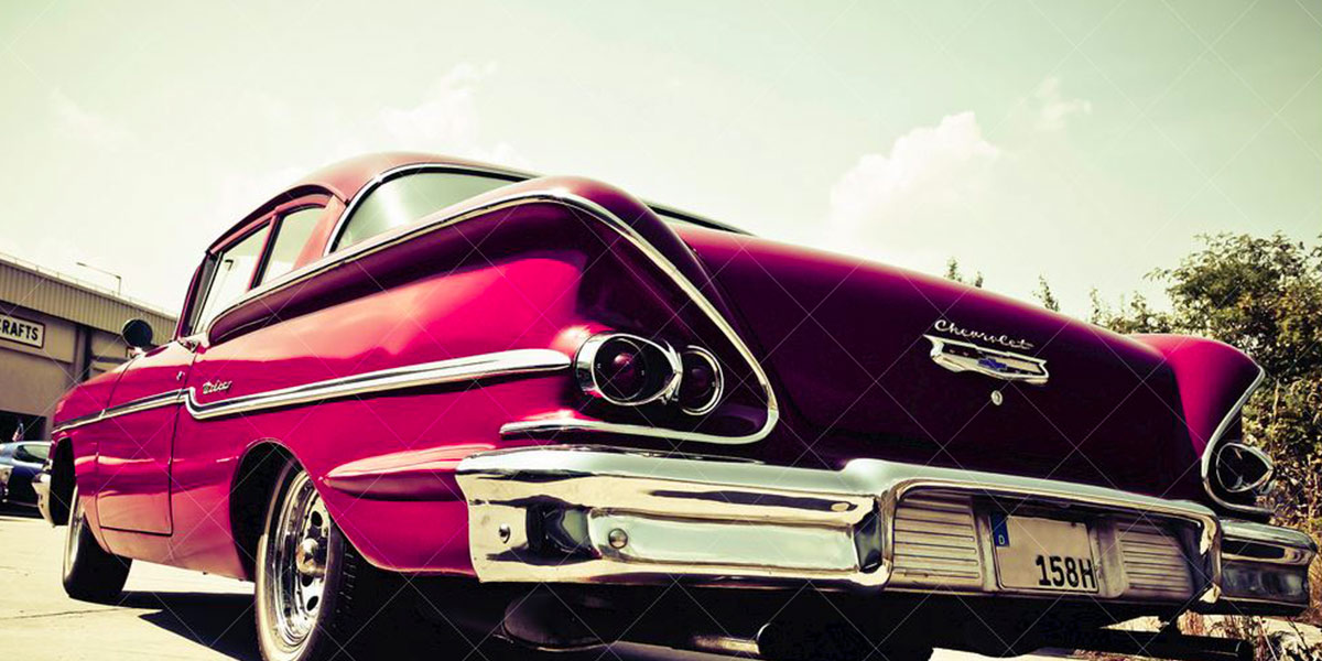 The rear of a large 1950's American car