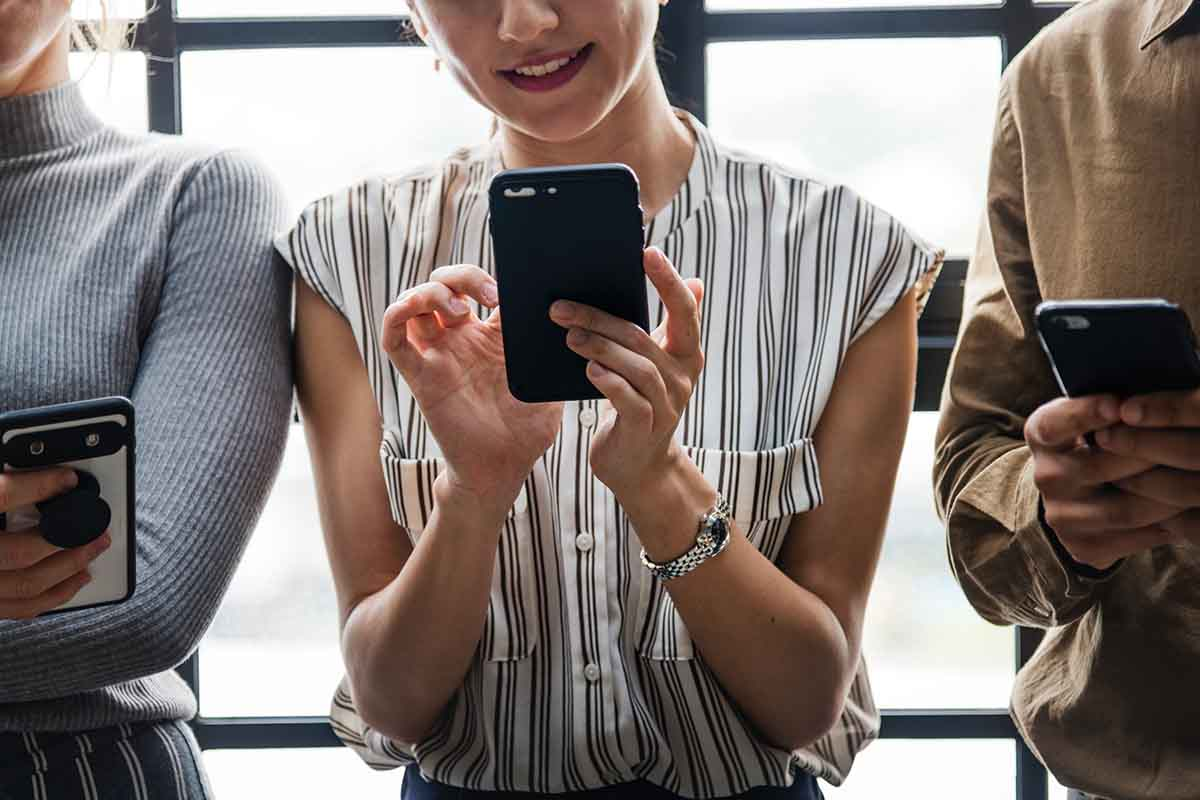 Woman looking at her mobile phone and smiling