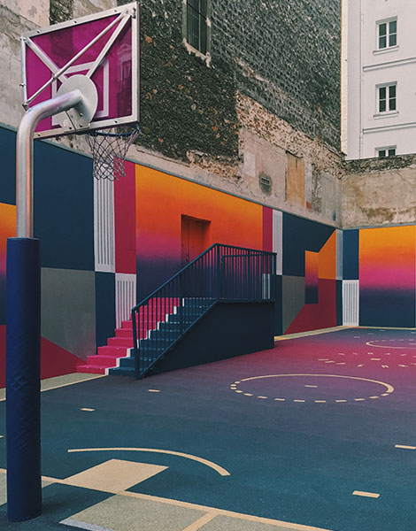 Outdoor sports area with basketball court in built up area