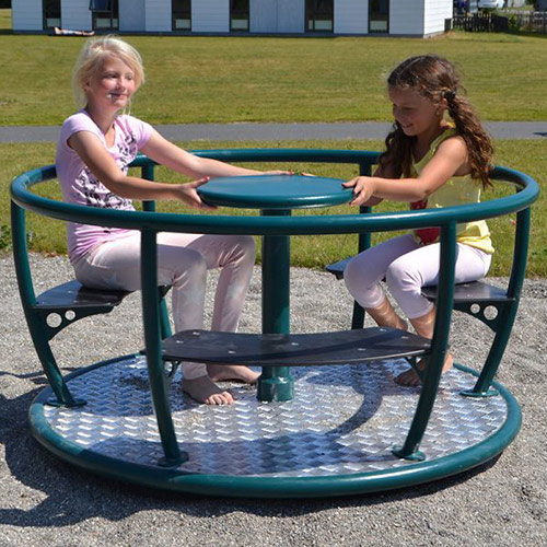 Children Spinning On Sitdown Roundabout Outdoors