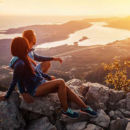 Couple Overlooking Scenery After Hiking