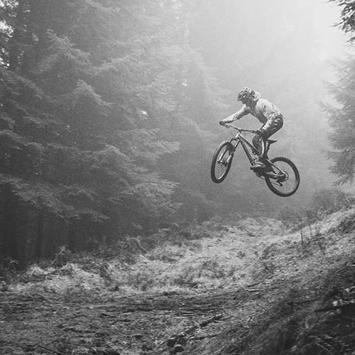 Black & White BMX Rider Jumping