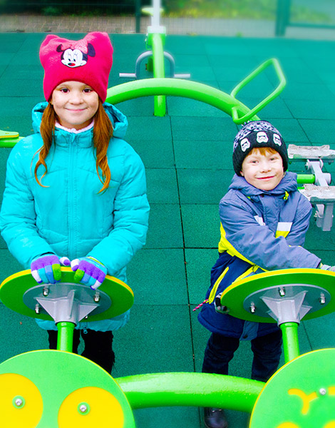 Children Playing On Outdoor Fitness Equipment