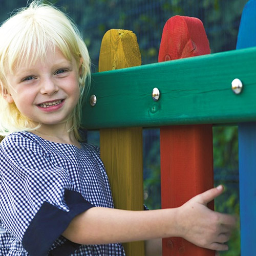 Park and playground fencing solutions child next to colourful timber fencing