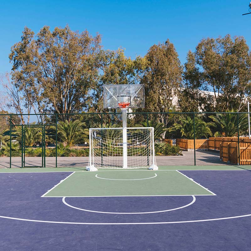 Multi Use Games Area (MUGA) pitch with basketball and football nets