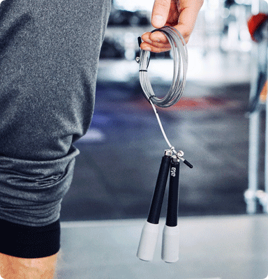 Person in gym holding skipping rope
