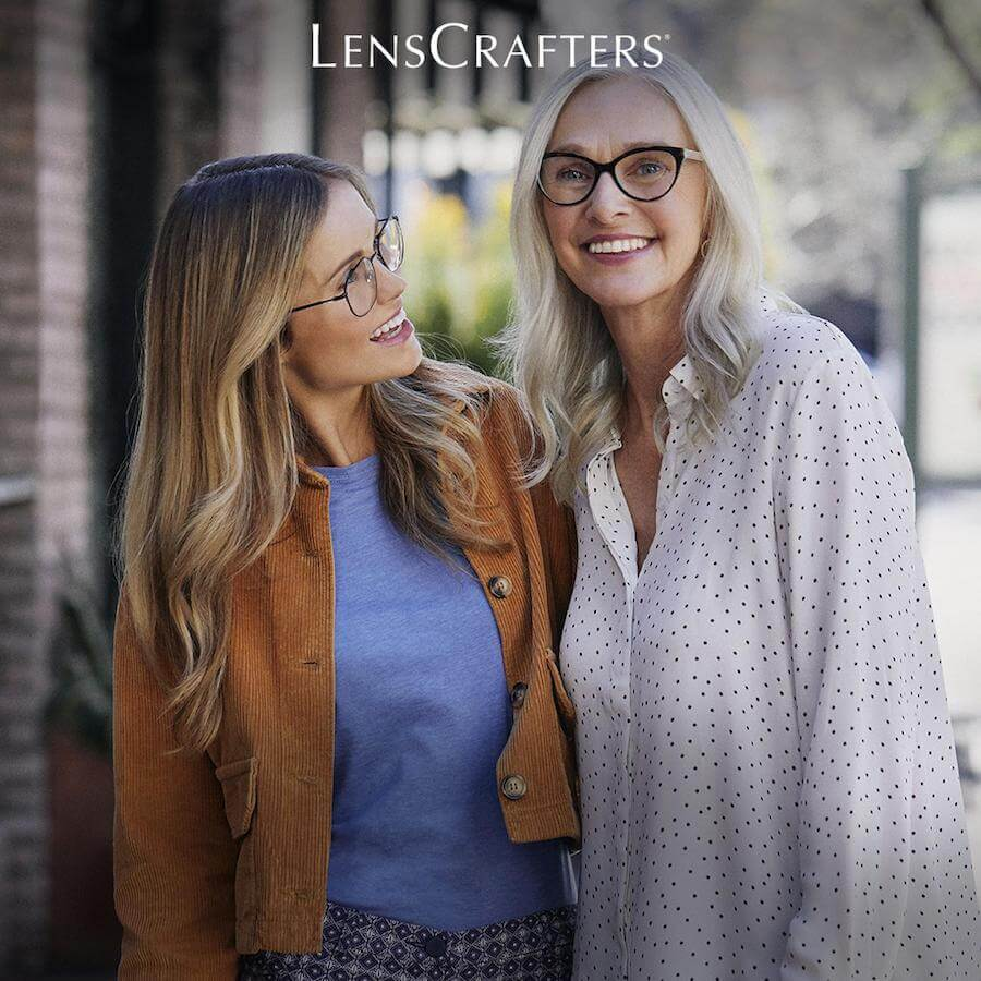 Smiling young woman and older woman both wearing glasses