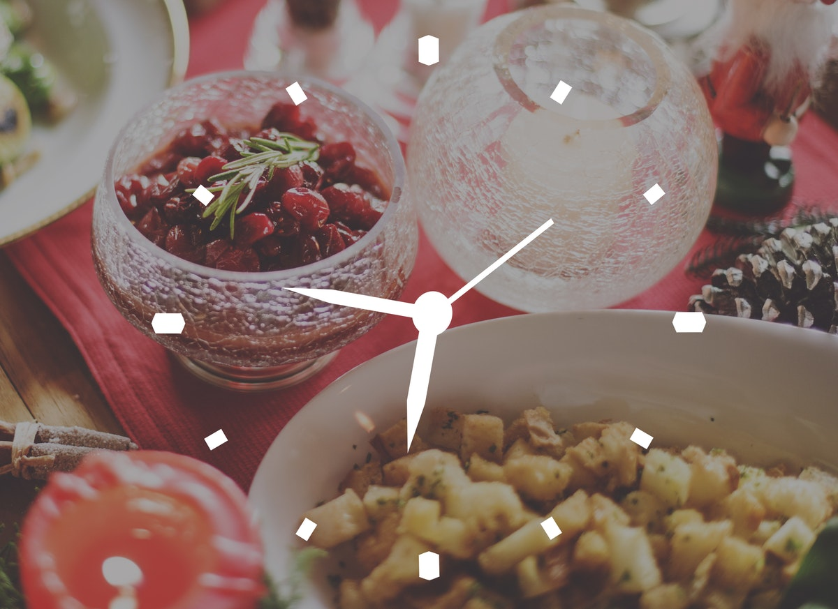 Photo of a festive dinner with a clock graphic overlaid
