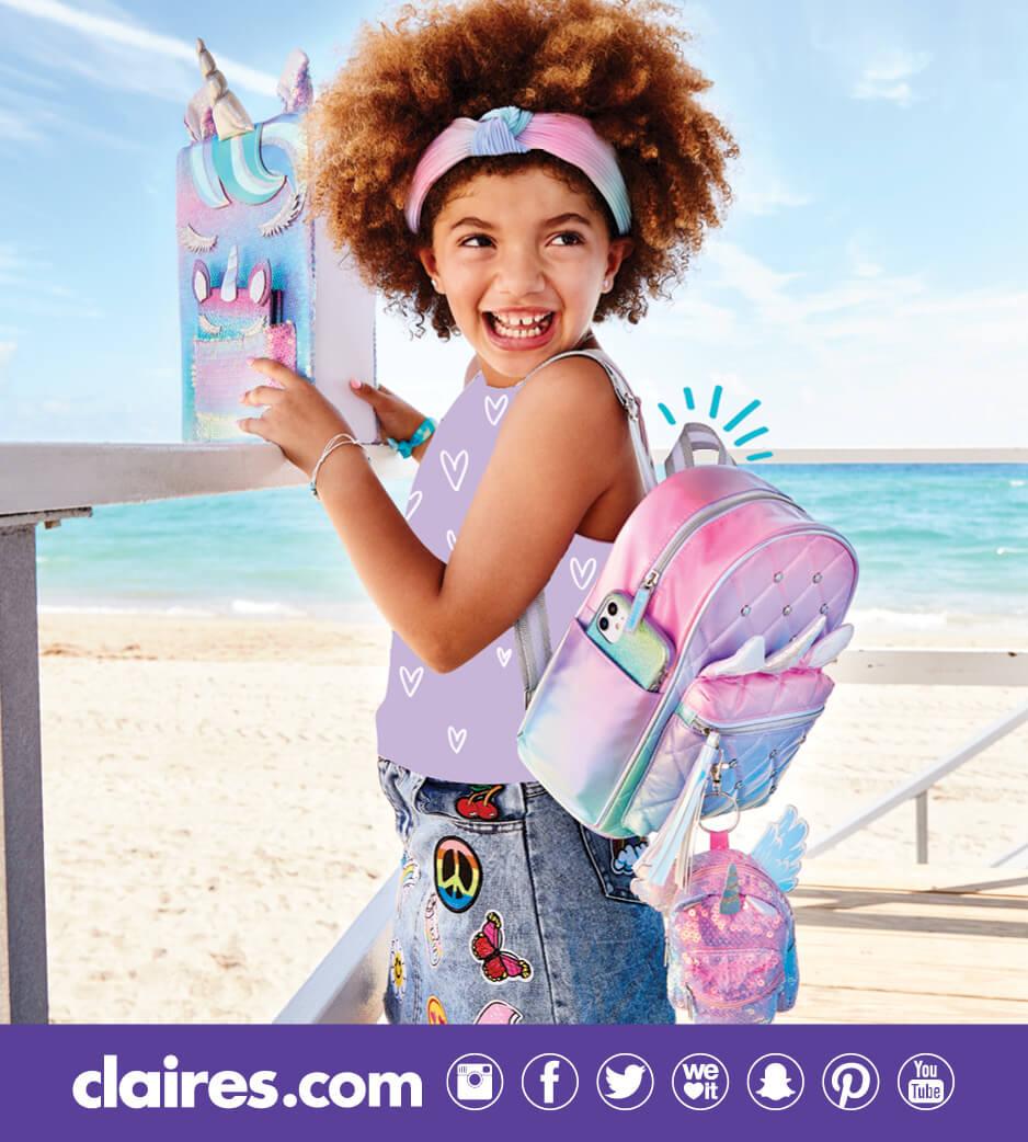 Young girl wearing a unicorn backpack