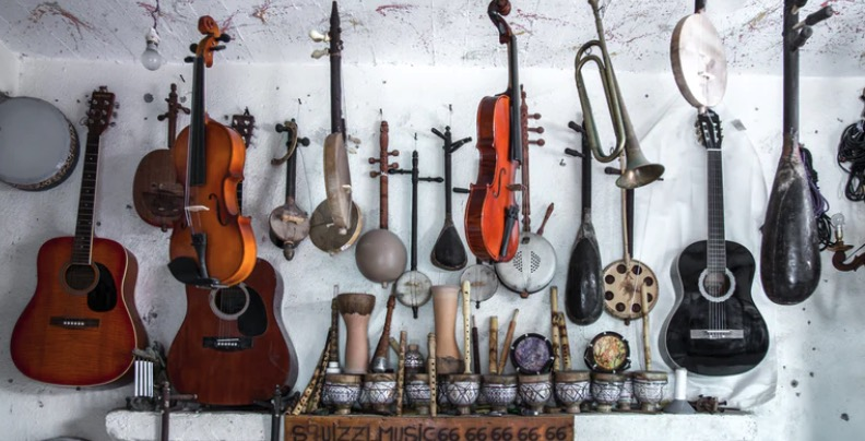 Musical Instruments displayed against a white wall.