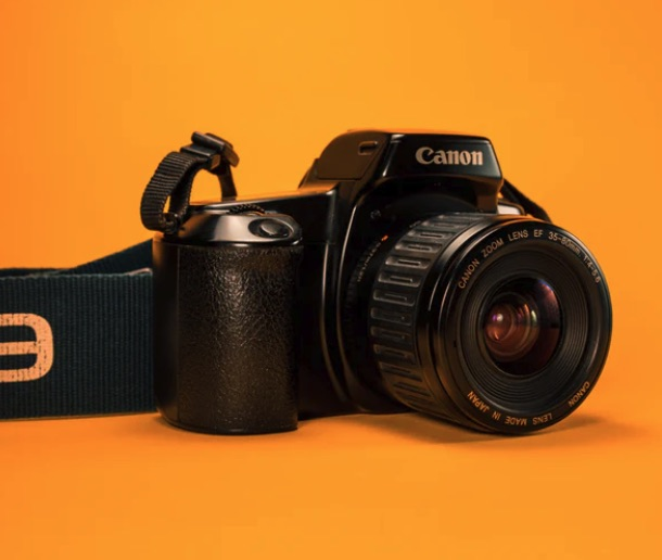 Camera with an orange background.