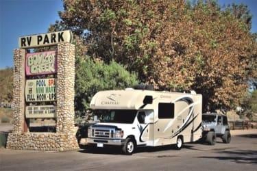 RV parked next to Boulder Creek sign