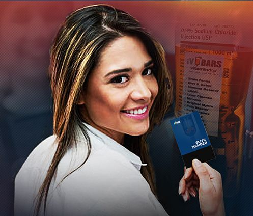 girl smiling and holding her iv bars elite member card