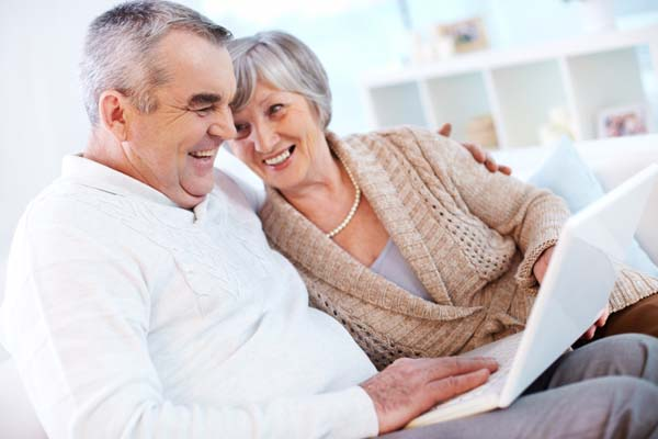 older couple looking on the computer